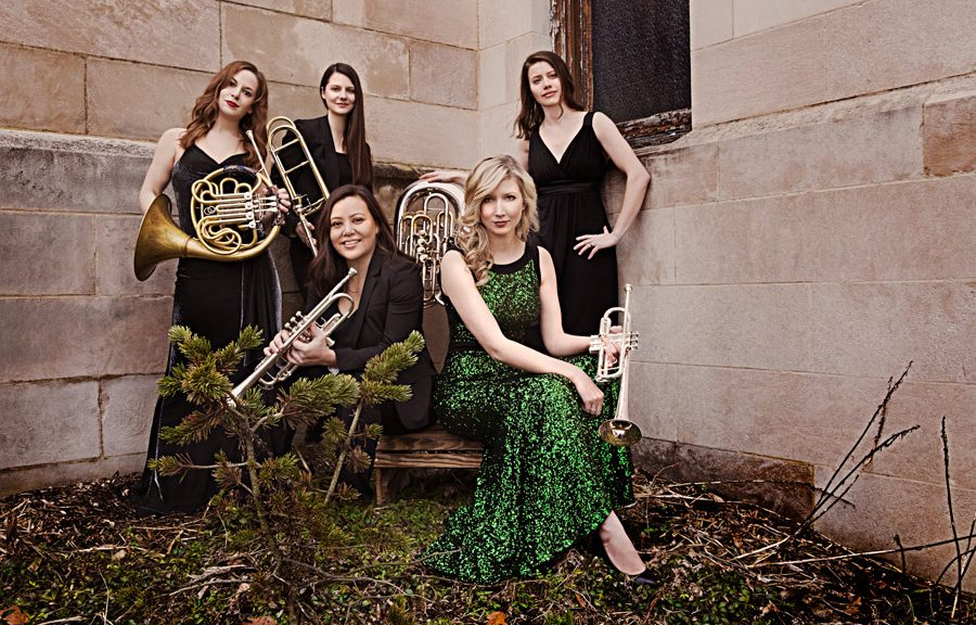 Seraph Brass Quintet in front of a stone wall